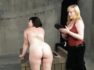 Blonde fingers and spanks her slave in hot BDSM action