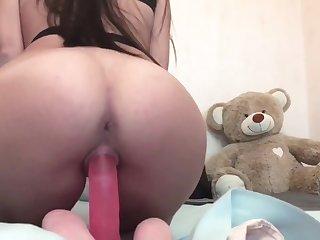 Skinny girl playing with a huge dildo