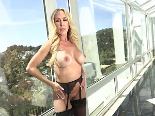 Matured light-complexioned pornstar Brandi Love gives a titjob and gets fucked