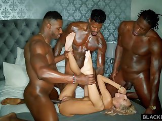 Three horny disgraceful guys are stretching one poor blonde cutie with their hard throbbing cocks
